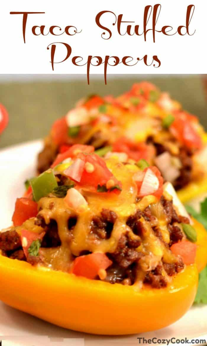 These savory taco stuffed peppers are filled with ground beef or turkey and sprinkled with your favorite taco toppings and melted cheese! #tacos #peppers #healthy #meat #protein #dinner #cheese #mexicanfood #groundbeef