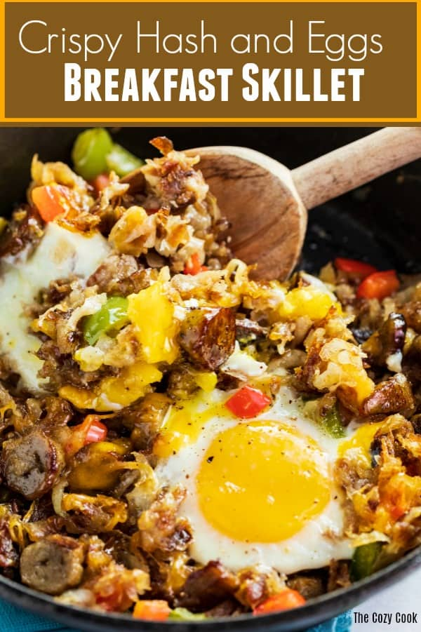 This breakfast skillet is loaded with crispy golden hash, mouth-watering sausage, and perfectly cooked eggs. All you need is a single skillet to make this deliciously satisfying breakfast!  | The Cozy Cook | #eggs #hash