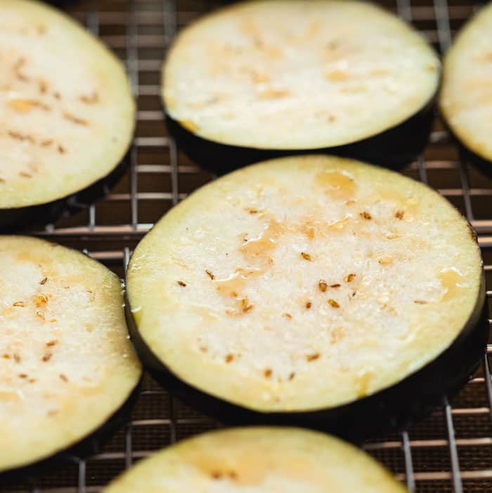 close up shot of an eggplant slice with moisture on top from salting it.