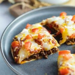 Taco Bell Mexican Pizza on a blue plate.