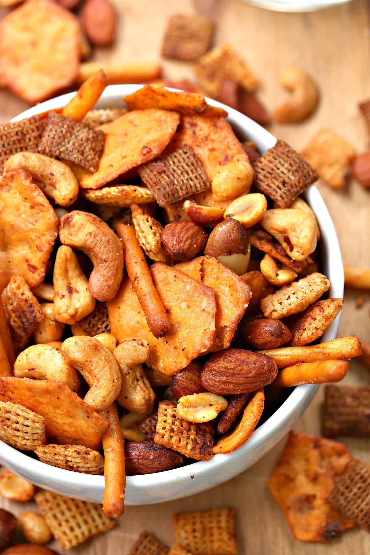 White Bowl overflowing with spicy chex mix