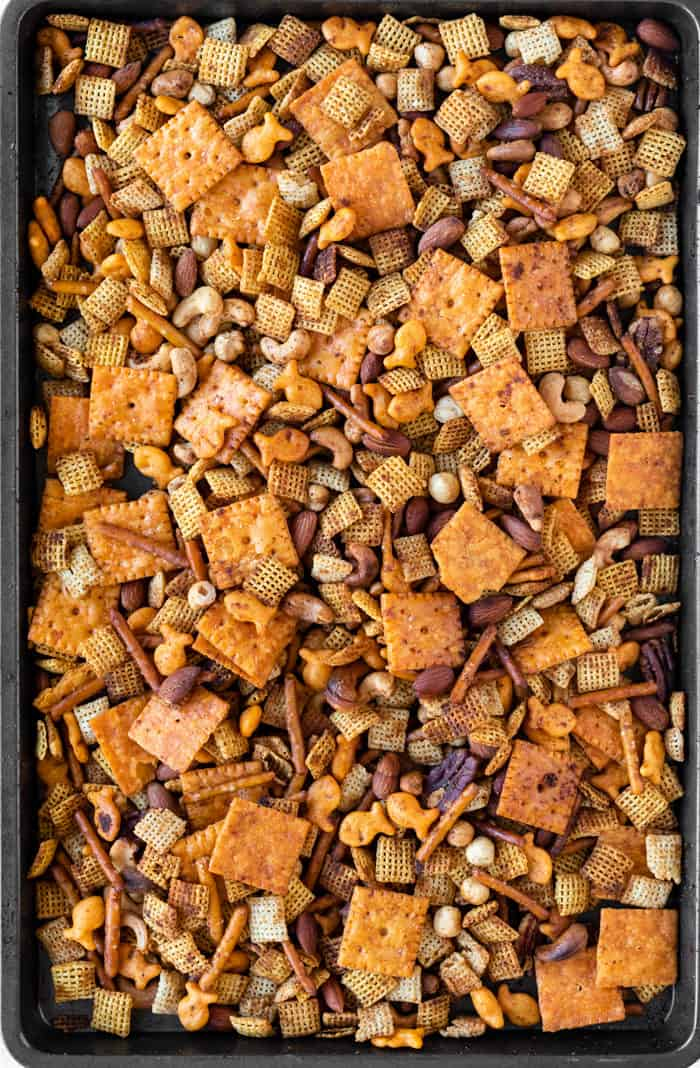 Baked chex mix on a large baking sheet