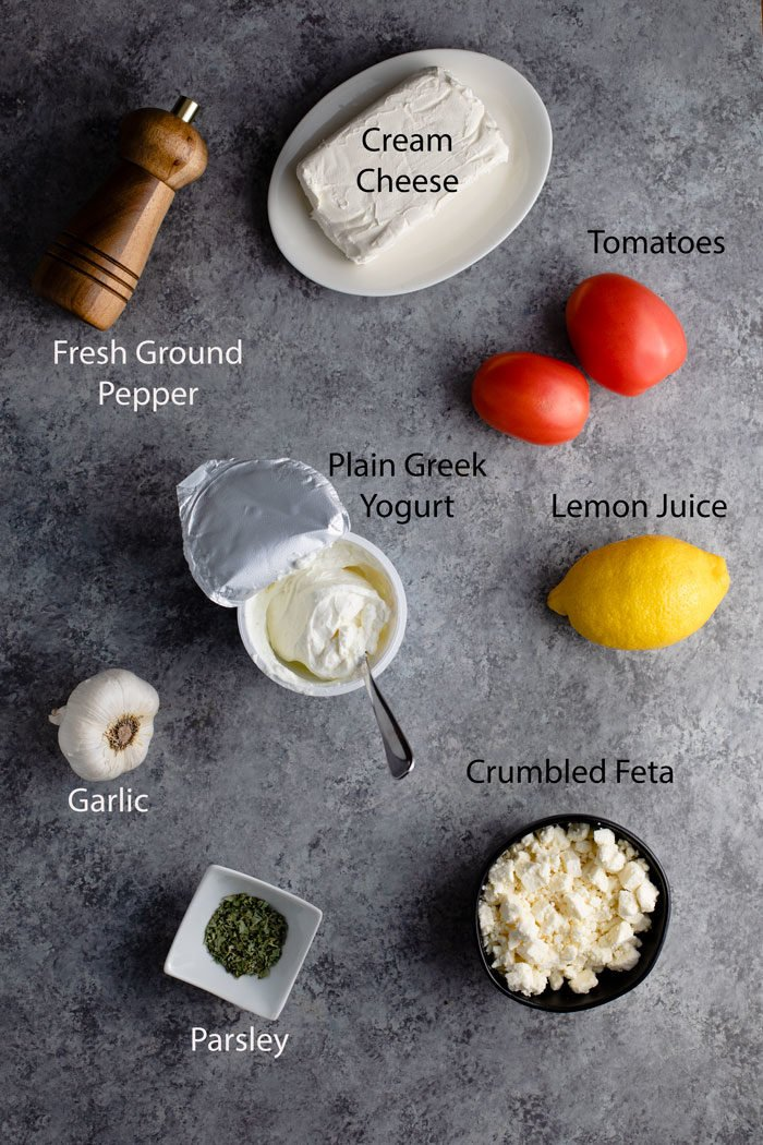 Overhead view of ingredients for making whipped garlic feta dip.