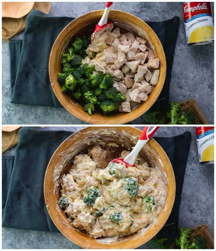 overhead shot of wooden bowl with chicken and broccoli being mixed with cheesy rice for casserole.