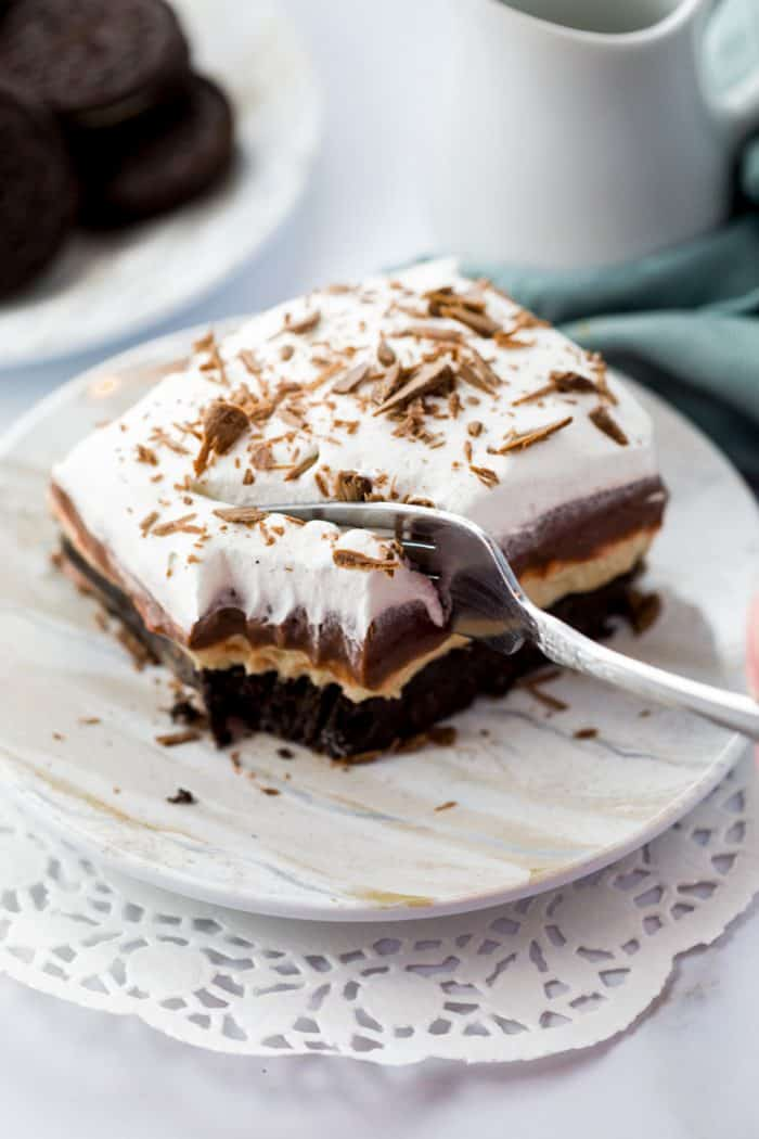 A fork cutting into No Bake Peanut Butter Pie