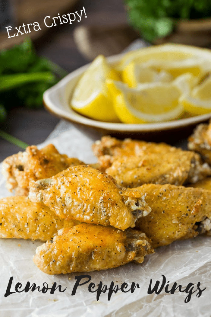 These lemon pepper wings are extra crispy and brushed with a simple combination of lemon and butter, then topped with freshly ground pepper. This post also includes tips on how to perfectly grill, bake, and fry the perfect crispy chicken wing. #chickenwings #wings #chicken #lemonpepper #lemon #appetizers #friedchicken #bakedchicken #grilledchicken #grilling #meat #partysnacks