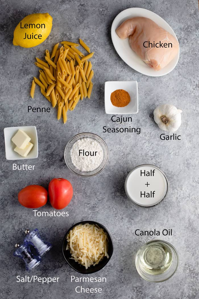 overhead shot of ingredients needed for cajun chicken pasta