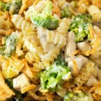 Creamy rotini noodles with chicken and broccoli for chicken noodle casserole.