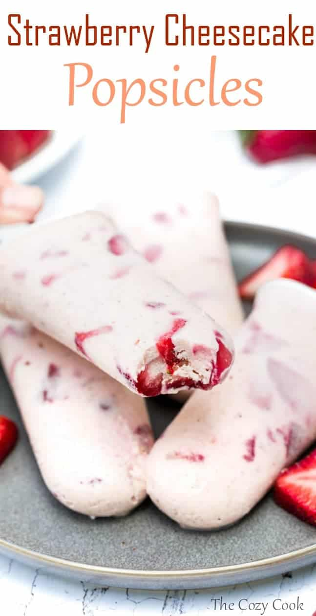 These easy-to-make popsicles are loaded with fresh strawberry slices surrounded by a creamy cheesecake filling. | The Cozy Cook | #Popsicles #dessert #summerrecipes #snacks #cheesecake #strawberries