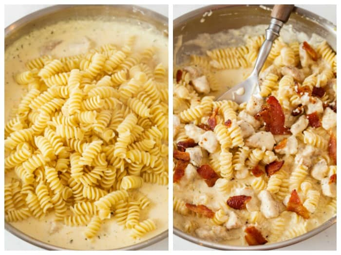 A skillet with cream sauce with pasta being added to make bacon ranch chicken pasta.