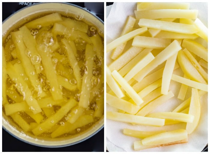 Lightly boiling sliced potatoes to make homemade french fries.