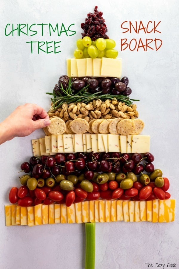 From decadent almonds, to savory olives, a variety of cheeses, and crunchy rice crackers, this Christmas Tree Snack Board has it all! Guests will love snacking from this festive board and it's so fun to put together! | The Cozy Cook | #cheeseplatter #christmas