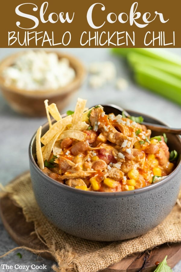 This buffalo chicken chili is loaded with juicy chicken is sprinkled with classic chili seasonings, buffalo sauce, corn, beans, and diced tomatoes. Then, it all simmers in the slow cooker before being topped with cilantro, blue cheese, and crunchy tortilla strips!   The Cozy Cook   #chili #buffalochicken
