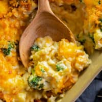 broccoli chicken rice casserole in a casserole dish with a wooden spoon.