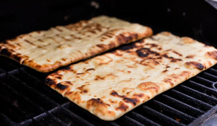 Flatbread pizza on a grill.