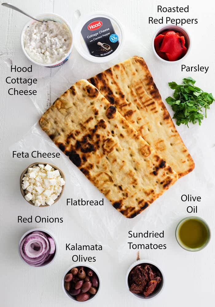 Overhead view of ingredients needed to make Grilled Greek Flatbread Pizza