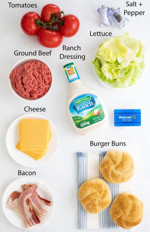 Overhead view of white surface topped with ingredients to make bacon ranch cheeseburgers.