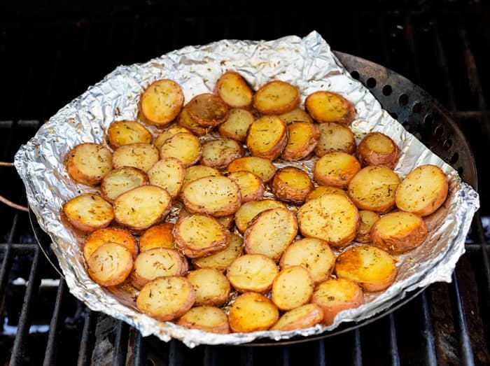 Roasted potatoes on foil on the grill.