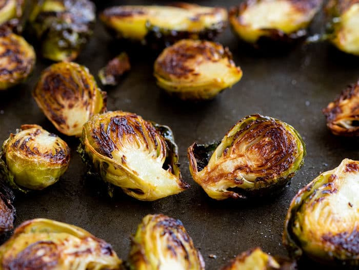 Roasted Brussels on a baking sheet.