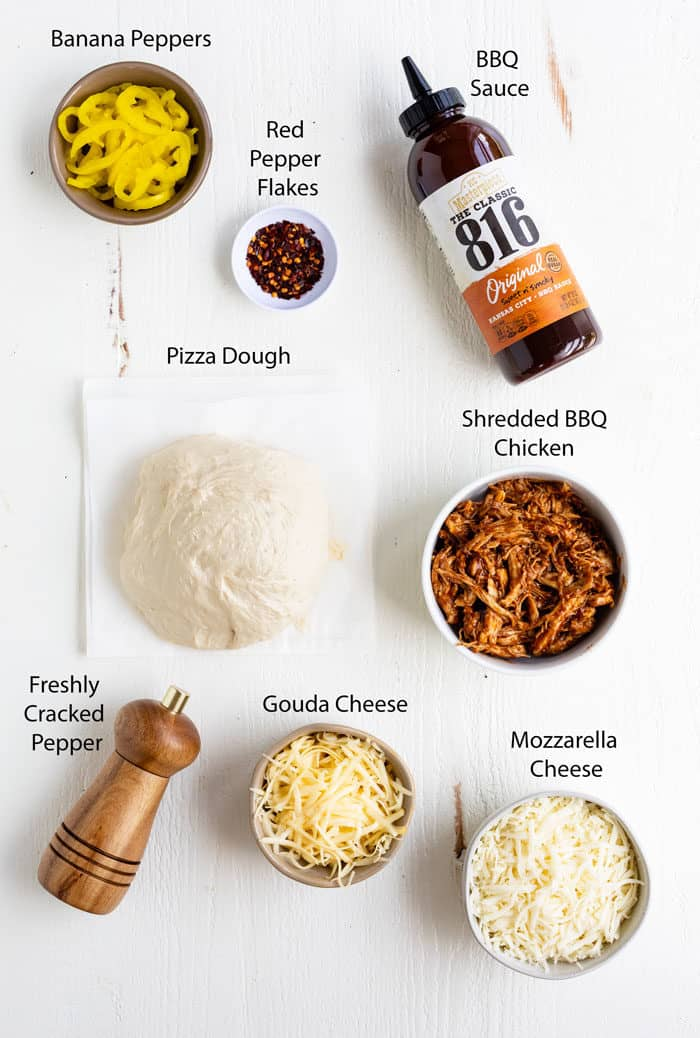Ingredients on a white table for making BBQ Chicken Pizza