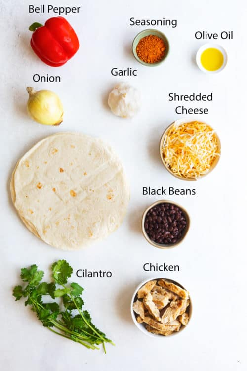 Overhead view of ingredients needed for chicken quesadillas.