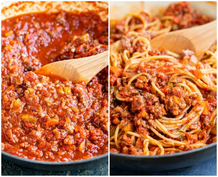 A skillet filled with bolognese sauce with spaghetti being added to it.