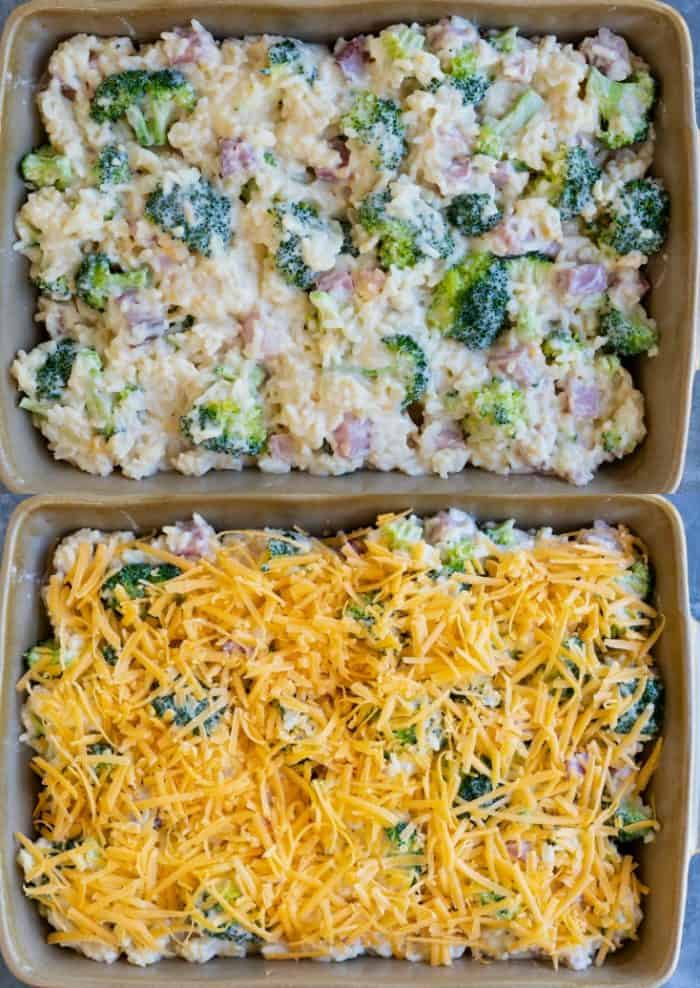 casserole dish filled with uncooked ham casserole ingredients and topped with grated cheese.