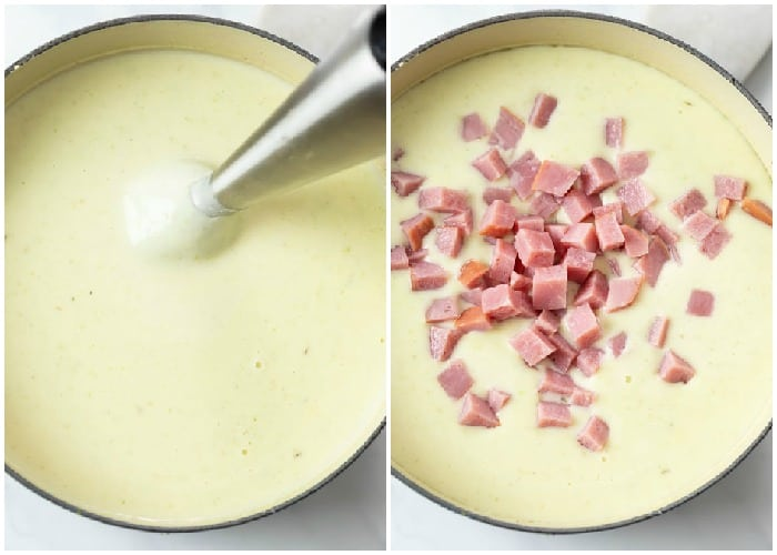 An immersion blender in a pot of soup with ham being added for ham and potato soup.