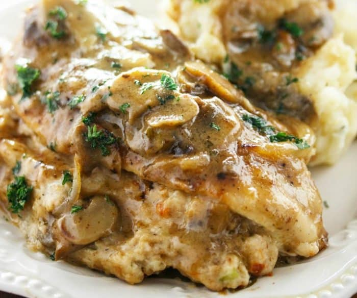 A white plate with olive garden's stuffed chicken marsala on top.