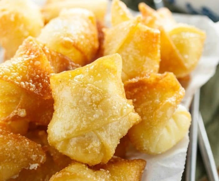 Golden Fried wontons folded up with sweet cream cheese filling inside.