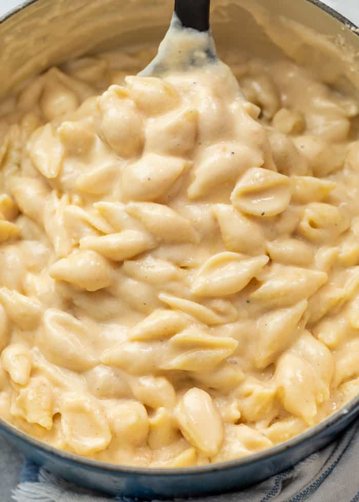 A pot full of creamy White Cheddar Shells and cheese for Panera Mac and Cheese recipe.