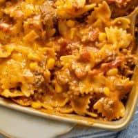 A close up view of pasta in a sloppy joe sauce in a casserole dish.