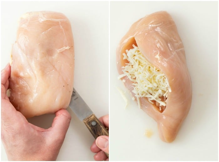A hand cutting a slice in a chicken breast to create a pocket to stuff mozzarella cheese inside.