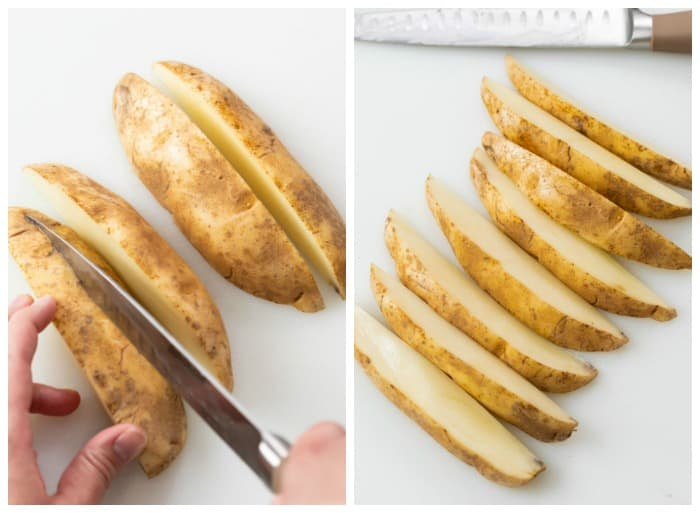 A russet potato being sliced to make wedge fries.