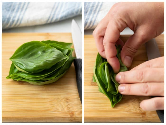 Rolling up a stack of basil leaves to chiffonade them.