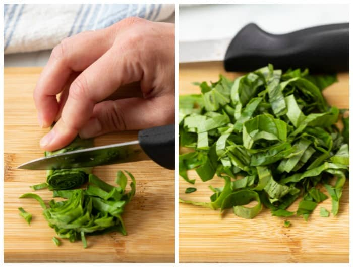 Cutting into a roll of basil to chiffonade it.