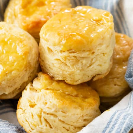 A bowl filled with fluffy Buttermilk Biscuits.