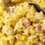 A fork scooping up Chicken Cordon Bleu Casserole with Rice.