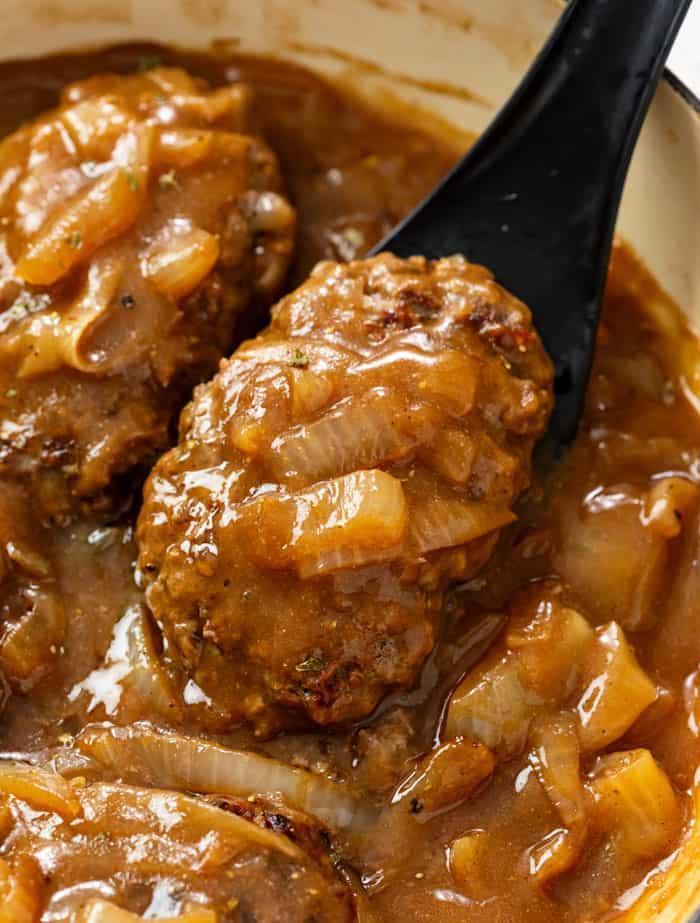 Hamburger Steak in brown gravy with onions.