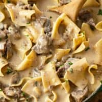 A pot filled with cream Beef Stroganoff with egg noodles.