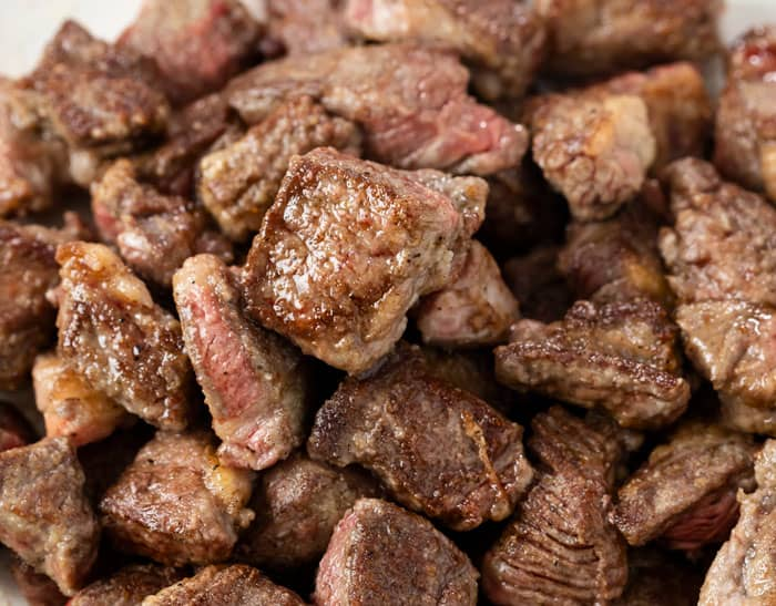Seared cubes of stew meat for making beef stroganoff.