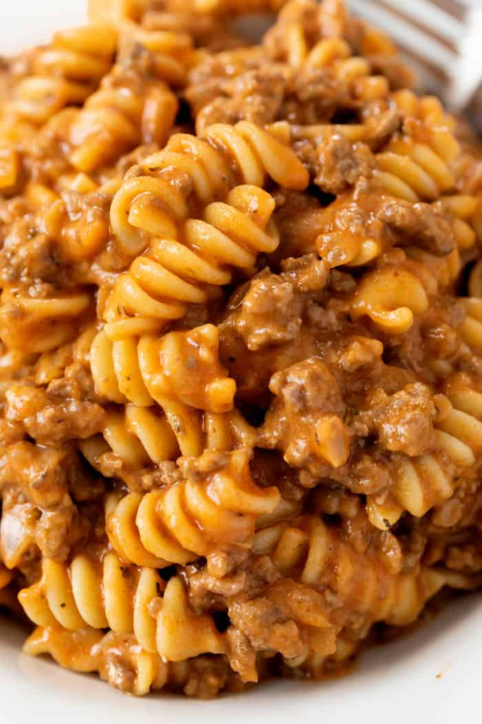 A close up view of Beef Pasta on a plate with creamy Rotini noodles.