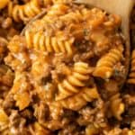 A wooden spoon full of creamy Ground Beef Pasta.
