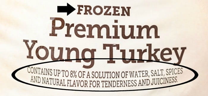 The label of a frozen turkey showing that it was injected with 8% of a salt solution.