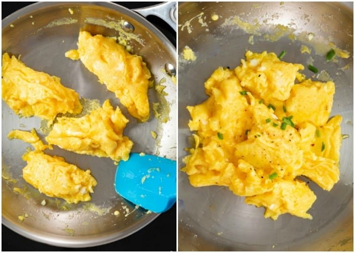 Finishing scrambled eggs in a pan and topping them with chives, salt, and pepper at the end.