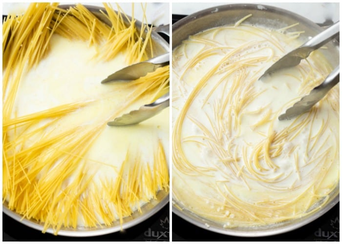 Angel hair pasta being added to cream sauce for Garlic Parmesan Pasta