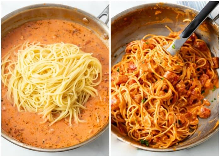 Adding spaghetti to a cream sauce for creamy tomato pasta.