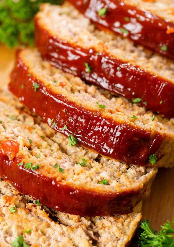 Turkey Meatloaf on a wooden surface cut into slices.