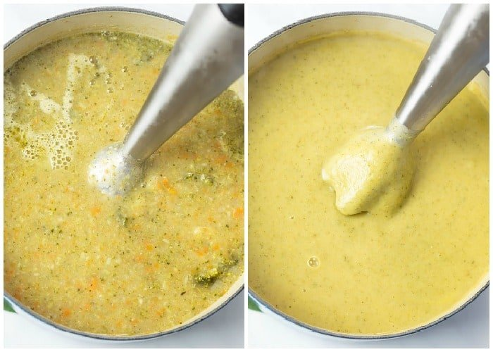 An immersion blender in a pot blending broth for cream of broccoli soup.