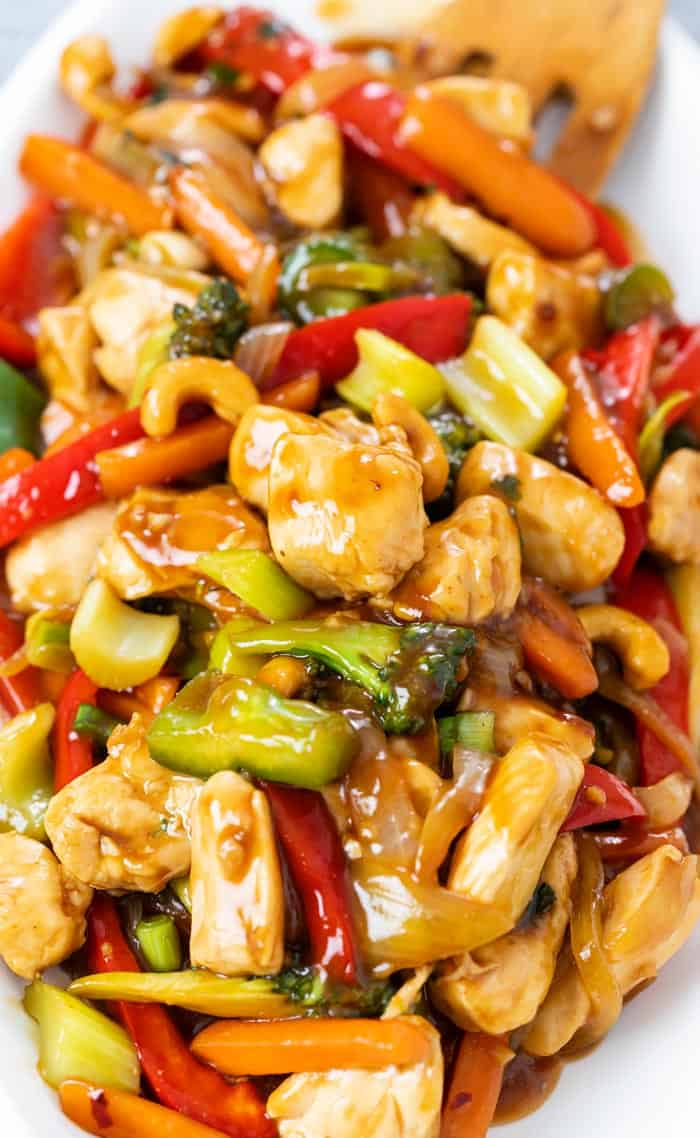 A close up view of chicken stir fry with vegetables and sauce.